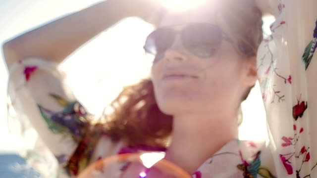 beautiful playing in the sun - sunglasses stock videos & royalty-free footage