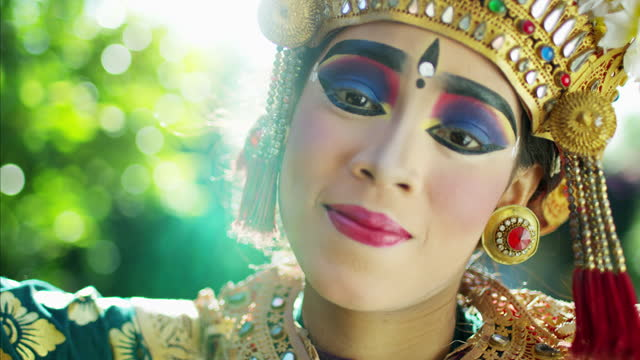 beautiful portrait painted eyes young artistic balinese dancer - headdress stock videos & royalty-free footage