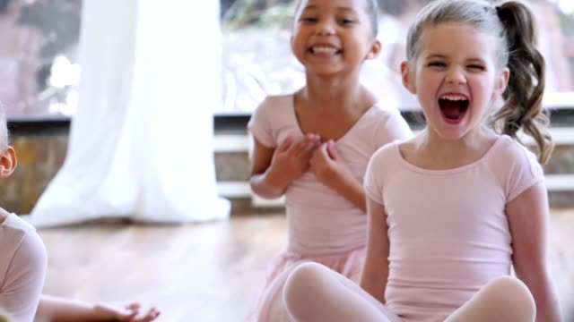 Beautiful preschool ballerinas prepare for ballet class