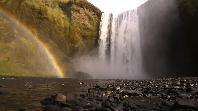 Beautiful Rainbow by the Skogafoss waterfall in Iceland