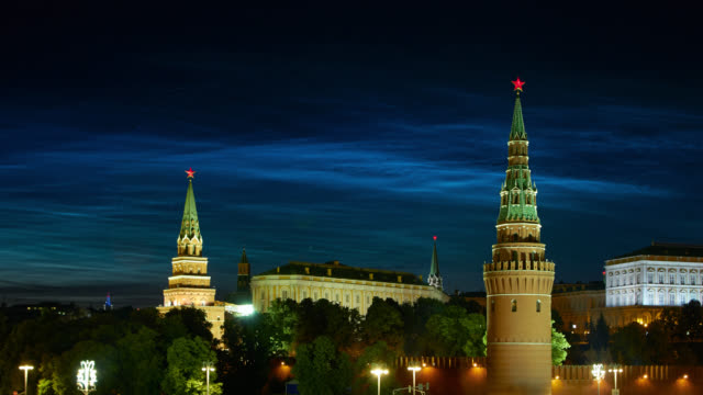 Beautiful rare natural phenomenon of Noctilucent clouds (night shining clouds) over the Moscow Kremlin at night