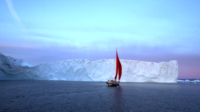 beautiful red ship sailing near majestic icebergs - disko bay, greenland - inlet stock videos & royalty-free footage