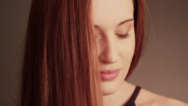 beautiful redhead girl tossing her long hair - straight hair stock videos & royalty-free footage