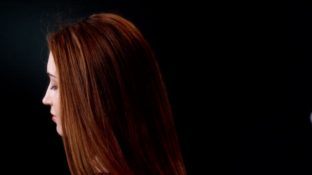 beautiful redhead girl tossing her long hair - hair straighteners stock videos and b-roll footage