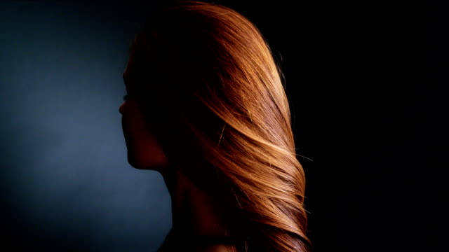 beautiful redhead girl tossing her long hair - smooth stock videos & royalty-free footage