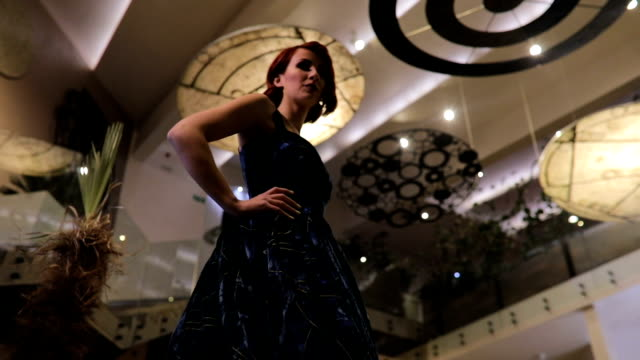 beautiful redhead lady in blue dress standing in hotel lobby - upper class stock videos & royalty-free footage