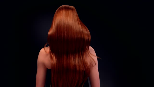 beautiful redhead woman tossing her long hair - hair treatment stock videos and b-roll footage