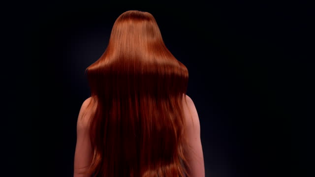 beautiful redhead woman tossing her long hair - swinging stock videos & royalty-free footage