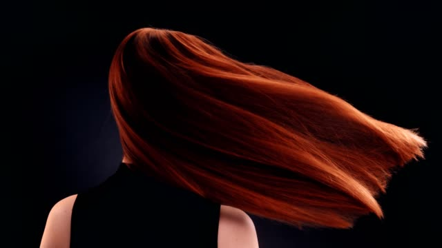 beautiful redhead woman tossing long hair - hairstyle stock videos & royalty-free footage