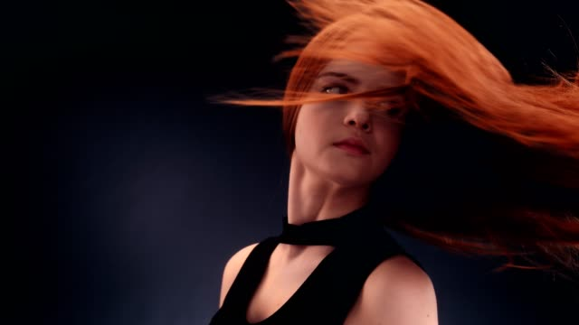 beautiful redhead woman tossing long hair - hair toss stock videos & royalty-free footage