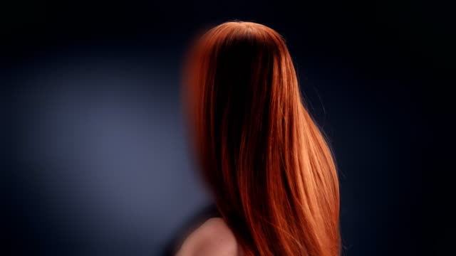 beautiful redhead woman tossing long hair - hair treatment stock videos and b-roll footage