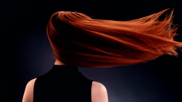 beautiful redhead woman tossing long hair - shampoo stock videos & royalty-free footage