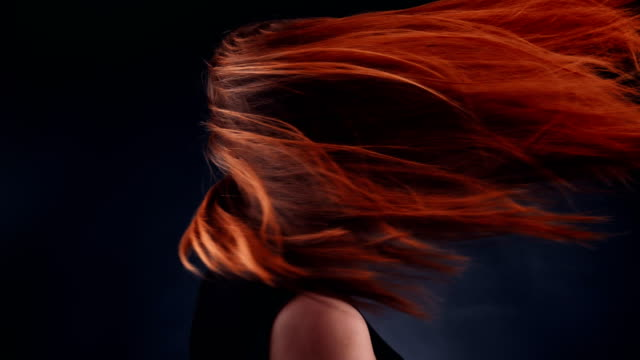 beautiful redhead woman tossing long hair - throwing stock videos & royalty-free footage