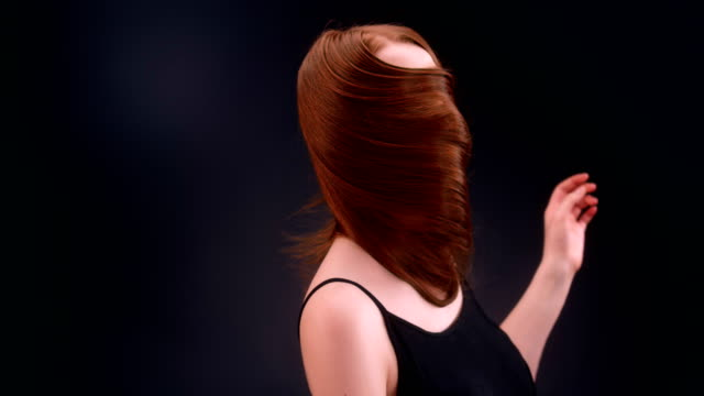 beautiful redhead woman tossing long hair - straight hair stock videos & royalty-free footage