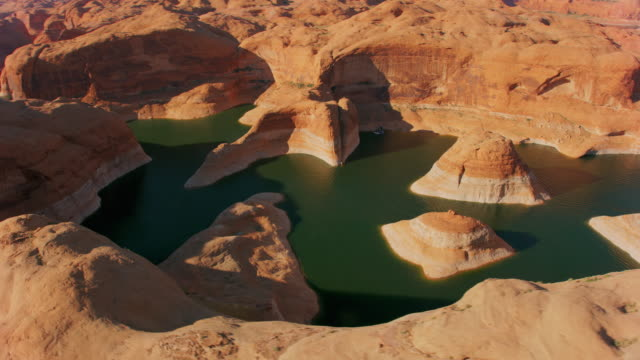 aerial beautiful reflection canyon, lake powell with round buttes rising above the water - lake powell stock videos & royalty-free footage