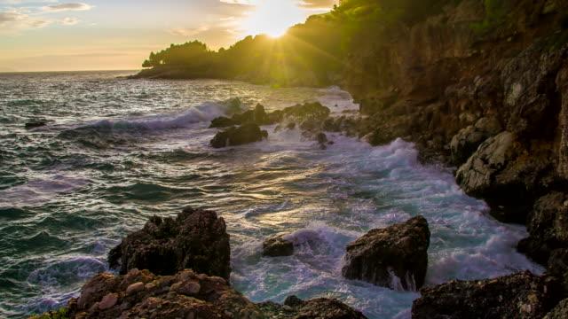 slo mo beautiful rocky coastline at sunset - rocky coastline stock videos & royalty-free footage
