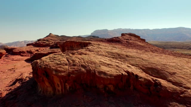beautiful rocky landscape with red soil. aerial view - desert stock videos & royalty-free footage