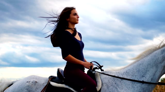 beautiful scene of natural beauty riding a horse in slow motion - horseback riding stock videos & royalty-free footage
