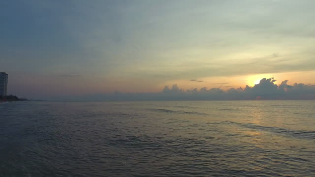 beautiful sea, flying over clean sea and wave surface at sunset or sunrise - mckyartstudio stock videos and b-roll footage