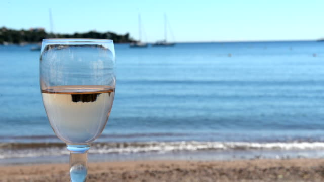 beautiful sea view and glass of wine - rose wine stock videos and b-roll footage
