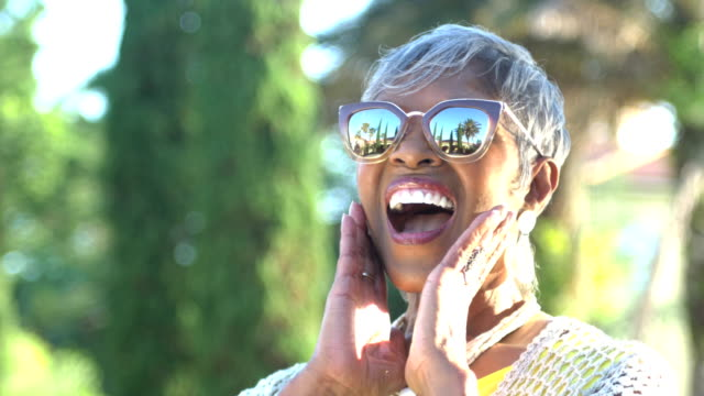 beautiful senior african-american woman with sunglasses - only senior women stock videos & royalty-free footage