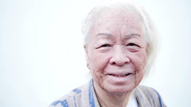 vídeos de stock e filmes b-roll de beautiful senior asian woman relax ans smile to camera. - old illustration