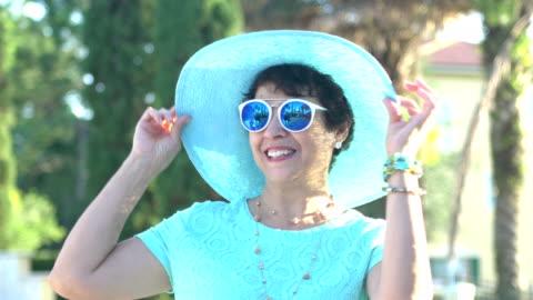 beautiful senior hispanic woman with sunglasses, hat - hat stock videos & royalty-free footage