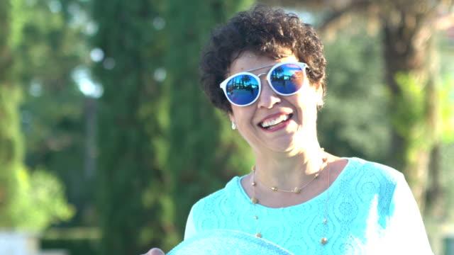 beautiful senior hispanic woman with sunglasses - sunglasses stock videos & royalty-free footage