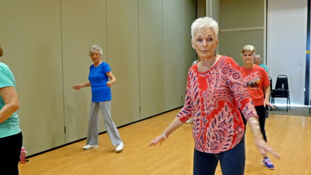 Beautiful senior woman have fun in dance class