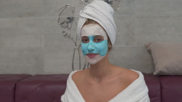 beautiful serene woman with a beauty mask - wearing a towel stock videos & royalty-free footage