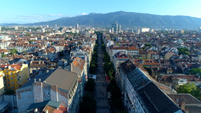 beautiful shot of a drone flying over main street in the downtown district in sofia, bulgaria - bulgaria video stock e b–roll