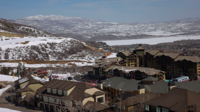 beautiful shot of ski resort on mountain against sky during sunny day - park city, utah - park city stock videos & royalty-free footage