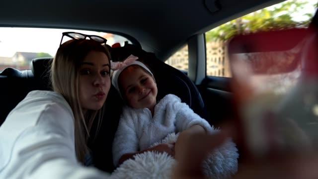 beautiful siblings taking a selfie in a car - viaggio in macchina video stock e b–roll