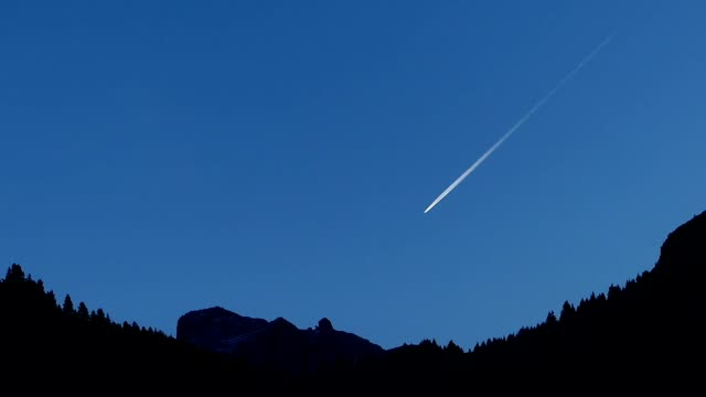 beautiful silhouette scene of dolomite alps in italy - vapour trail stock videos & royalty-free footage