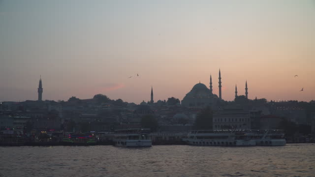 beautiful silhouette view of touristic landmarks at at eminönü (turyol)  harbour at sunset among air pollution - bosphorus stock videos & royalty-free footage