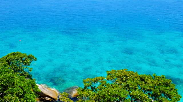 beautiful similan andaman sea with emerald color of crystal-clear water, phuket, thailand - andaman sea stock videos & royalty-free footage