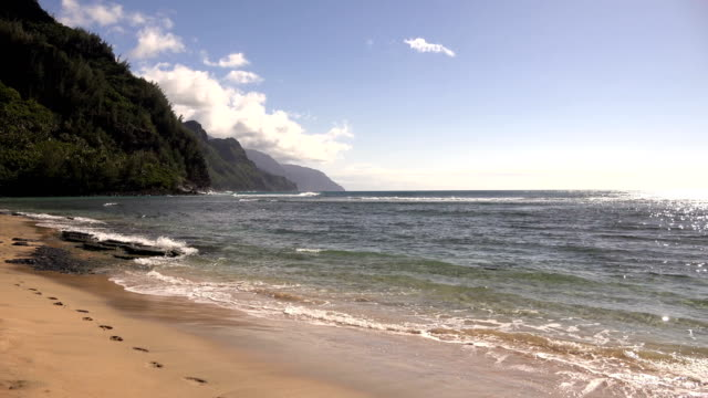 beautiful skies above beach on kauai island - butte rocky outcrop stock videos & royalty-free footage