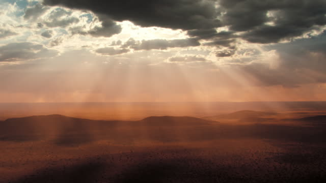 A beautiful sky shines over the Kalahari Desert. Available in HD.
