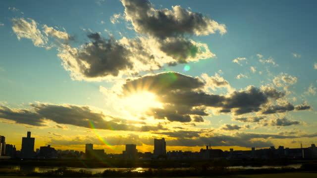 beautiful sky with sun rays tokyo. - plusphoto stock videos & royalty-free footage