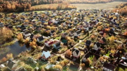 Beautiful small village or township in the autumn forest.
