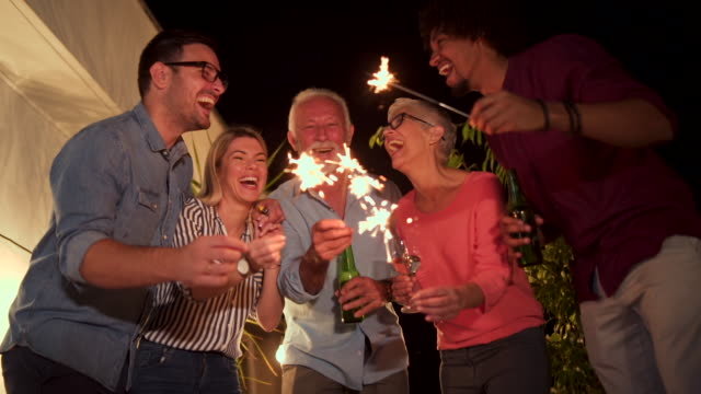 beautiful smiling family celebrating new year's eve - new year's eve stock videos and b-roll footage