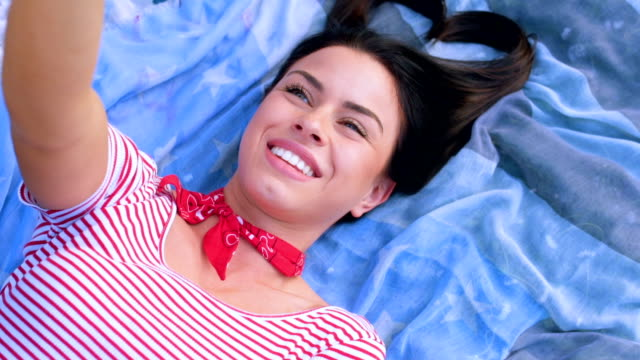 beautiful smiling woman takes photos of her - bubble gum stock videos & royalty-free footage