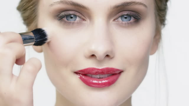 beautiful smiling woman using make-up brush - red lipstick stock videos & royalty-free footage