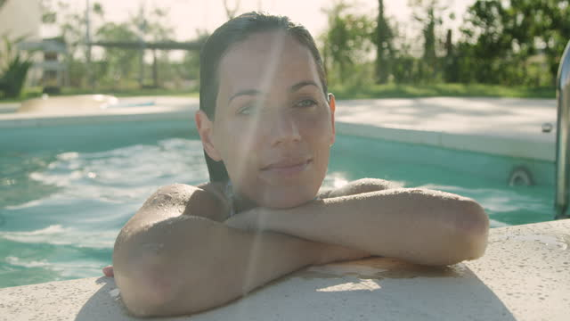 beautiful smiling young woman leaning on her arms at the poolside - wet stock videos & royalty-free footage