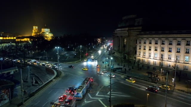 beautiful static aerial drone shot of a crossroad at sofia city central district at night - bulgaria stock videos & royalty-free footage