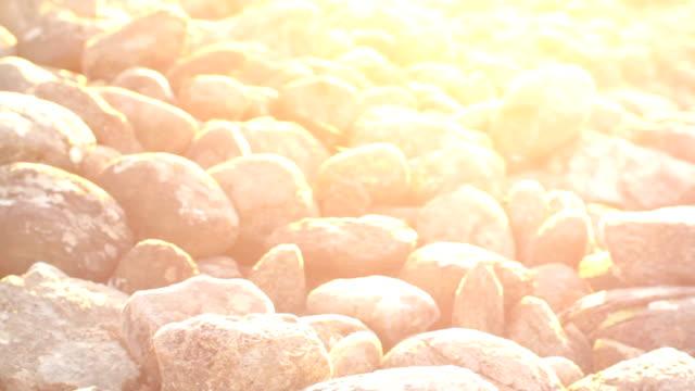beautiful stones - varmt ljus bildbanksvideor och videomaterial från bakom kulisserna