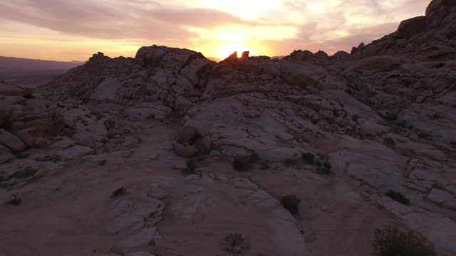 epic beautiful sun through rocks fly over - drone aerial video 4k arizona, utah, moab desert, open plain, trail, adventure, discovery landscape, reveal, beautiful, prairie, sun reveal beautiful 4k sports - prairie stock videos and b-roll footage