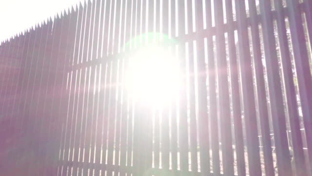 beautiful sunlight through the fence - fence stock videos & royalty-free footage