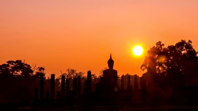 Beautiful sunrise at unrise sky at Sukhothai Historical Park, a UNESCO world heritage site, Thailand