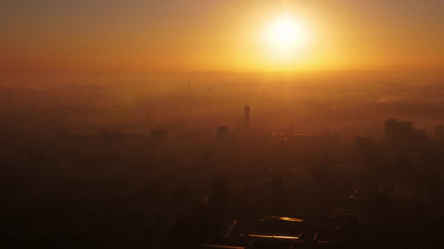 beautiful sunrise in pyongyang with morning fog. view from above. north korea, dprk. - spoonfilm stock videos and b-roll footage